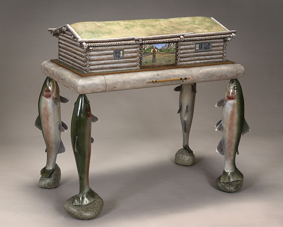 Maine woodworker, sculptor and furniture maker Thomas Dahlke's sense of visual humor extends to tables, desks and cabinets with deer feet, sheep legs and horses' hooves, all beautifully carved and embellished with miniature paintings.